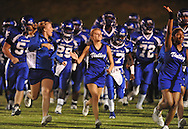 Water Valley cheerleaders lead the team on the field vs. Charleston in Water Valley, Miss.  on Friday, September 16, 2011.