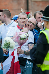 An EDL (English Defence League) organised event to lay flowers at Barkers Pool War Memorial Sheffield,  in memory of Drummer Lee Rigby, resulted in a two hour stand off when Sheffield Unite Against Fascism and One Sheffield Many Cultures supporters occupied Barkers Pool and surrounded the War Memorial leaving police to keep the opposing factions apart. <br /> EDL supporters wait behind the police cordon<br /> 1 June 2013