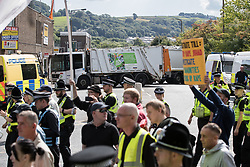 © Licensed to London News Pictures . 02/09/2017 . Keighley , UK . Bin lorries are used as barries to seal off roads in the town along the march route . Far-right street protest movement , the English Defence League ( EDL ) , hold a demonstration in the West Yorkshire town of Keighley , opposed by anti-fascists , including Unite Against Fascism ( UAF ) . The EDL say they are demonstrating against the sexual grooming and abuse of English girls by Muslim men and against terrorism across the UK . Photo credit : Joel Goodman/LNP