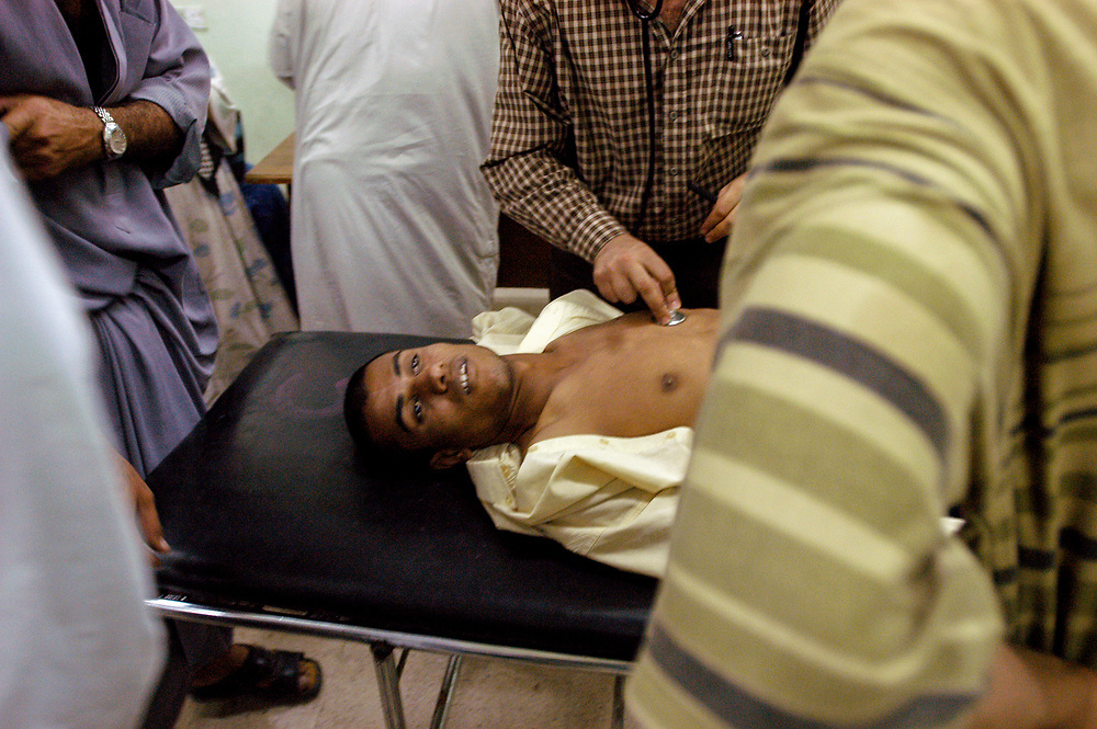 A young man dead on arrival with a bullet in his chest at the al-Kadisia Hospital emergency room in Thora City, formerly known as Saddam City. The area is a vast slum of 3 million Shiite Muslims, long oppressed and marginalized by Saddam's regime. The neighborhood is a hotbed for the insecurity and violence that has thrived with the absence of authority in the country.<br /> Baghdad, Iraq. 06/05/2003.