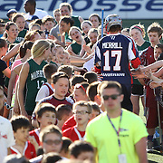Brodie Merrill #17 of the Boston Cannons runs through fans prior to the game at Harvard Stadium on May 17, 2014 in Boston, Massachuttes. (Photo by Elan Kawesch)