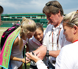 LONDON, ENGLAND - Sunday, July 3, 2011: Eugenie Bouchard (CAN) & Grace Min (USA) look at the back of a photographer's camera after the Girls' Doubles Final match on day thirteen of the Wimbledon Lawn Tennis Championships at the All England Lawn Tennis and Croquet Club. (Pic by David Rawcliffe/Propaganda)
