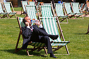 UNITED KINGDOM, London: 14 May 2019 <br /> A businessman takes a sip of water as he relaxes in the sunshine in Green Park on another fine day of weather across The UK. Temperatures are set to reach 19C in the capital and potentially higher in the Midlands.