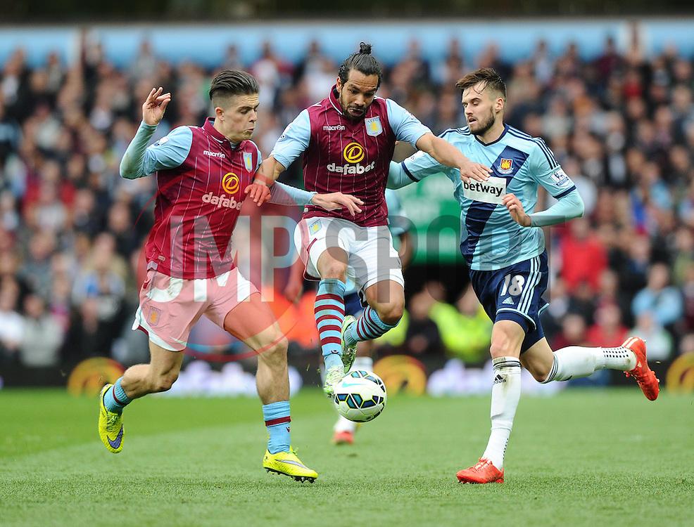 Aston Villa's Jack Grealish and Aston Villa's Kieran Richardson go for the same ball  - Photo mandatory by-line: Joe Meredith/JMP - Mobile: 07966 386802 - 09/05/2015 - SPORT - Football - Birmingham - Villa Park - Aston Villa v West Ham United - Barclays Premier League