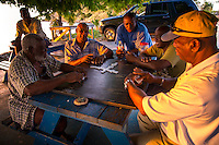Crocus Bay, Anguilla - January 7, 2015: Local men play dominoes as the sun sets on Crocus Bay. CREDIT: Chris Carmichael for The New York Times