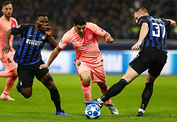November 7, 2018 - Milan, Italy - Kwadwo Asamoah (L) of Inter Milan and Milan Skriniar of Inter Milan vie for the ball with Luis Suarez (C) of Barcelona during the Group B match of the UEFA Champions League between FC Internazionale and FC Barcelona on November 6, 2018 at San Siro Stadium in Milan, Italy. (Credit Image: © Mike Kireev/NurPhoto via ZUMA Press)