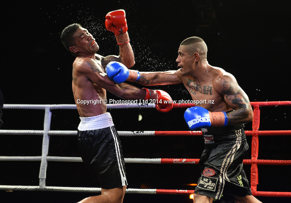 Adrian Taihia ( Blue Gloves ) versus Togasilimai Letoa during the Triple Thriller Boxing event held at The Logan Campbell Centre. Auckland, New Zealand. Thursday 22 May 2014. Photo: Andrew Cornaga/www.photosport.co.nz