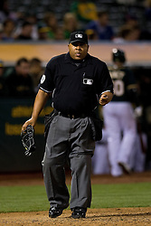 OAKLAND, CA - JUNE 10:  MLB umpire Adrian Johnson #80 stands on the field during the sixth inning between the Oakland Athletics and the Texas Rangers at O.co Coliseum on June 10, 2015 in Oakland, California. The Oakland Athletics defeated the Texas Rangers 5-4. (Photo by Jason O. Watson/Getty Images) *** Local Caption *** Adrian Johnson