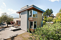 A new home built by NZ Builders features contemporary architecture by 519 Design/Build and uses locally sourced materials and and efficient rainwater storage system.