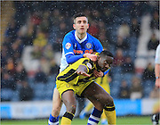 Goalscorer Lucas Akins, Matty Lund during the Sky Bet League 1 match between Rochdale and Burton Albion at Spotland, Rochdale, England on 30 January 2016. Photo by Daniel Youngs.