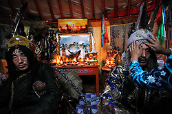 Mongolian Shaman brothers Gankhuyag (C) and Batgerel Batmunkh (R) dress up in their Shaman  costumes before performing a Shaman healing ritual in their ger on the outskirts of Ulan Bator, Mongolia, 04 July 2012. Mongolian brothers Gankhuyag and Batgerel Batmunkh share a similar fate. Both were construction workers before fate calls on them to take on their Shamanic roles to serve the spirits. Shamanism comes from the term 'shamans' that refers to priests or mediums that acts as vessels for spirits, gods and demons to communicate with the human world. In Mongolia, they adhere to the ancient beliefs of Tengrism, where spirits live in all of nature, in the sun, moon, lakes, rivers, mountains, and trees.