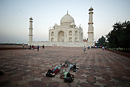 A group of tourists admire The Taj Mahal.  Agra, India
