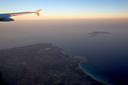 FlyNiki Airbus 321 shortly after take-off from Palma de Mallorca Airport at sunset, flying over Es Trenc, Colo?nia Sant Jordi and Cap de ses Salines. Cabrera Island in background.