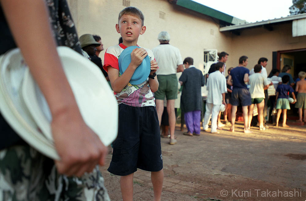 White homeless family line up for food distribution in shelter near Johannesburg, South Africa on April 2002.