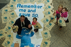 Environment minister Richard Lockhead launced a new public awareness campaign ahead of the introduction of a 5p charge for each single use carrier bag given to shoppers. Mr Lockhead was joined by Isaac Lee (aged 3) , Imogen Smith (aged three) and her Grandmother Aileen Smith at the launch. Edinburgh,  25 September 2014 Ger Harley | StockPix.eu