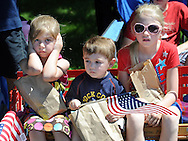WARMINSTER, PA - MAY 26:  From left, Leah Distler, 6, covers her ears while Micah Distler, 3, and Allyson Brown, 9 of Warminster, Pennsylvania watch the Warminster Memorial Day Parade and Ceremony May 26, 2014 in Warminster, Pennsylvania. (Photo by William Thomas Cain/Cain Images)