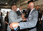 Jan 9, 2018; Alameda, CA, USA; Tim Brown (left) and Jerry Rice shake hands at a press conference to introduce Jon Gruden as Oakland Raiders head coach at the Raiders headquarters.