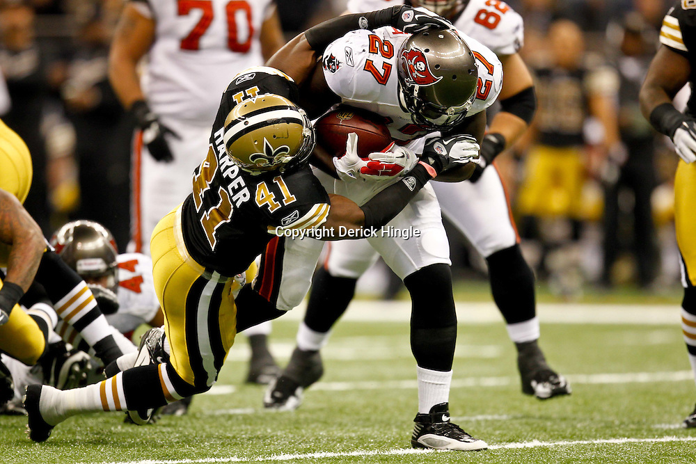 November 6, 2011; New Orleans, LA, USA; Tampa Bay Buccaneers running back LeGarrette Blount (27) is tackled by New Orleans Saints safety Roman Harper (41) during the first quarter of a game at the Mercedes-Benz Superdome. Mandatory Credit: Derick E. Hingle-US PRESSWIRE