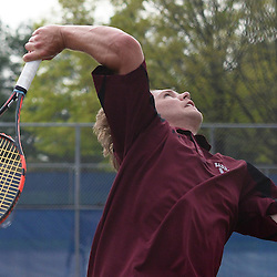 Staff photos by Tom Kelly IV<br /> Radnor's Will Frigerio serves during the first singles match to Unionville's Zeyad Zaki during the District One tennis match between Radnor and Unionville at Unionville High School in East Marlborough Township, Tuesday afternoon.