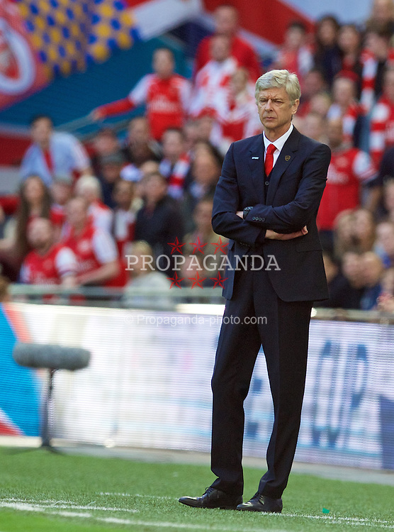 LONDON, ENGLAND - Saturday, April 18, 2015: Arsenal's manager Arsene Wenger during the FA Cup Semi-Final match against Reading at Wembley Stadium. (Pic by David Rawcliffe/Propaganda)