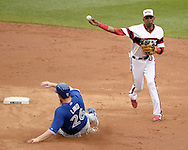CHICAGO - AUGUST 17:  Alexei Ramirez of the Chicago White Sox turns a double play against the Toronto Blue Jays on August 17, 2014 at U.S. Cellular Field in Chicago, Illinois.   (Photo by Ron Vesely)