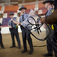 HARRISBURG, PA - APRIL 21:  Police officers attach plastic handcuffs before the Republican presidential hopeful Donald Trump holds a campaign rally at the Pennsylvania Farm Show Complex & Expo Center on April 21, 2016 in Harrisburg, Pennsylvania.  The Pennsylvania Primary takes place on April 26.  (Photo by Mark Makela/Getty Images)