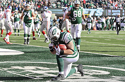 Dec 24, 2011; East Rutherford, NJ, USA; New York Jets tight end Josh Baker (45) celebrates a 5 yard touchdown pass from New York Jets quarterback Mark Sanchez (6) during the first half of their game against the New York Giants at MetLife Stadium.