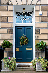 Christmas Wreath off door of house in Edinburgh's New Town , Scotland, UK