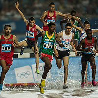 Athletes compete in the Men's 2,000 m Steeplechase Final at the Nanjing Olympic Sports Center during the Nanjing 2014 Youth Olympic Games in Nanjing, China 25 August 2014