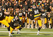 November 02 2013: Iowa Hawkeyes kicker Mike Meyer (96) kicks a field goal from the hold of Iowa Hawkeyes punter Connor Kornbrath (98) during the first half of the NCAA football game between the Wisconsin Badgers and the Iowa Hawkeyes at Kinnick Stadium in Iowa City, Iowa on November 2, 2013. Wisconsin defeated Iowa 28-9.