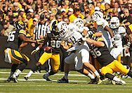 September 21 2013: Western Michigan Broncos quarterback Zach Terrell (11) fumbles as he is hit by Iowa Hawkeyes defensive lineman Drew Ott (95) during the third quarter of the NCAA football game between the Western Michigan Broncos and the Iowa Hawkeyes at Kinnick Stadium in Iowa City, Iowa on September 21, 2013. Iowa defeated Western Michigan 59-3.