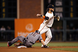 SAN FRANCISCO, CA - APRIL 18:  Brandon Crawford #35 of the San Francisco Giants completes a double play past Chris Owings #16 of the Arizona Diamondbacks during the seventh inning at AT&T Park on April 18, 2016 in San Francisco, California.  (Photo by Jason O. Watson/Getty Images) *** Local Caption *** Brandon Crawford; Chris Owings