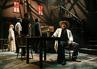 "Samuel Shurtleff as Bert Barricune sits with a drink as folks pay their respects during the funeral of Liberty Valance during Wednesday's dress rehearsal at the Winnipesaukee Playhouse for their upcoming show ""The Man Who Shot Liberty Valance"".   (Karen Bobotas/for the Laconia Daily Sun)"