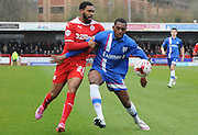 Gavin Tomlin and Amari'i Bell jostling for the ball during the Sky Bet League 1 match between Crawley Town and Gillingham at the Checkatrade.com Stadium, Crawley, England on 28 March 2015. Photo by Michael Hulf.