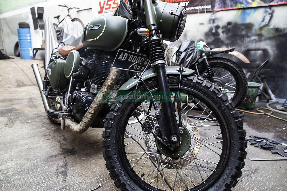 July 26, 2018 - South Tangerang, Banten, Indonesia - Bintaro, South Tangeran, Indonesia July 26th 2018 : Customize Motor Bike at Bintaro, South Tangerang, Banten, Indonesia by the brand name ''The Katros''. The Katros becoming famous because of it's detailing process in customizing of the bike as the what the customer want, made oldest son of JOKOWIDODO the president of Indonesia GIBRAN RAKABUMING RAKA customize his Indian Motorcycle brand Royal Enfield customized. Each motor bike took 3-4 months  for the customization process. (Credit Image: © Donal Husni via ZUMA Wire)