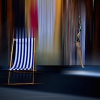conceptual image with deckchair and female figure