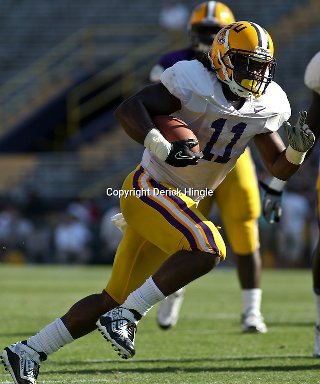 April 9, 2011; Baton Rouge, LA, USA; LSU Tigers running back Spencer Ware (11) scores a touchdown during the 2011 Spring Game at Tiger Stadium.   Mandatory Credit: Derick E. Hingle