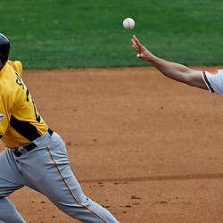 Mar 1, 2013; Sarasota, FL, USA; Pittsburgh Pirates right fielder Travis Snider (23) is caught in a run down with Baltimore Orioles first baseman Steve Pearce (28) during the top of the sixth inning of a spring training game at Ed Smith Stadium. Mandatory Credit: Derick E. Hingle-USA TODAY Sports
