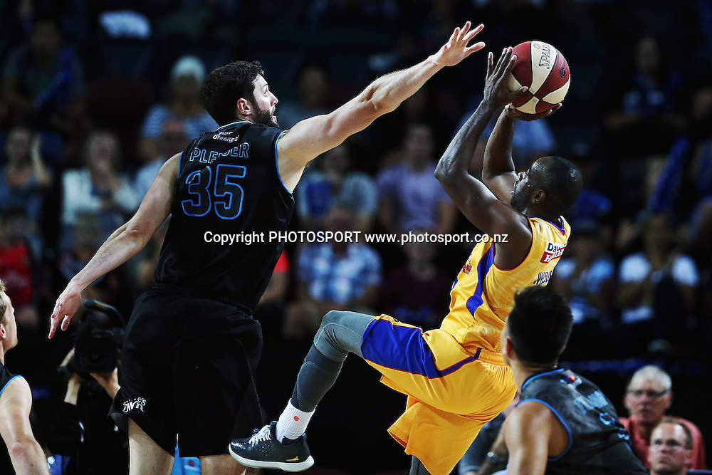Alex Pledger of the Breakers defends the shot from Jamar Wilson of the 36ers. 2014/15 ANBL, SkyCity Breakers vs Adelaide 36ers, Vector Arena, Auckland, New Zealand. Thursday 12 February 2015. Photo: Anthony Au-Yeung / www.photosport.co.nz