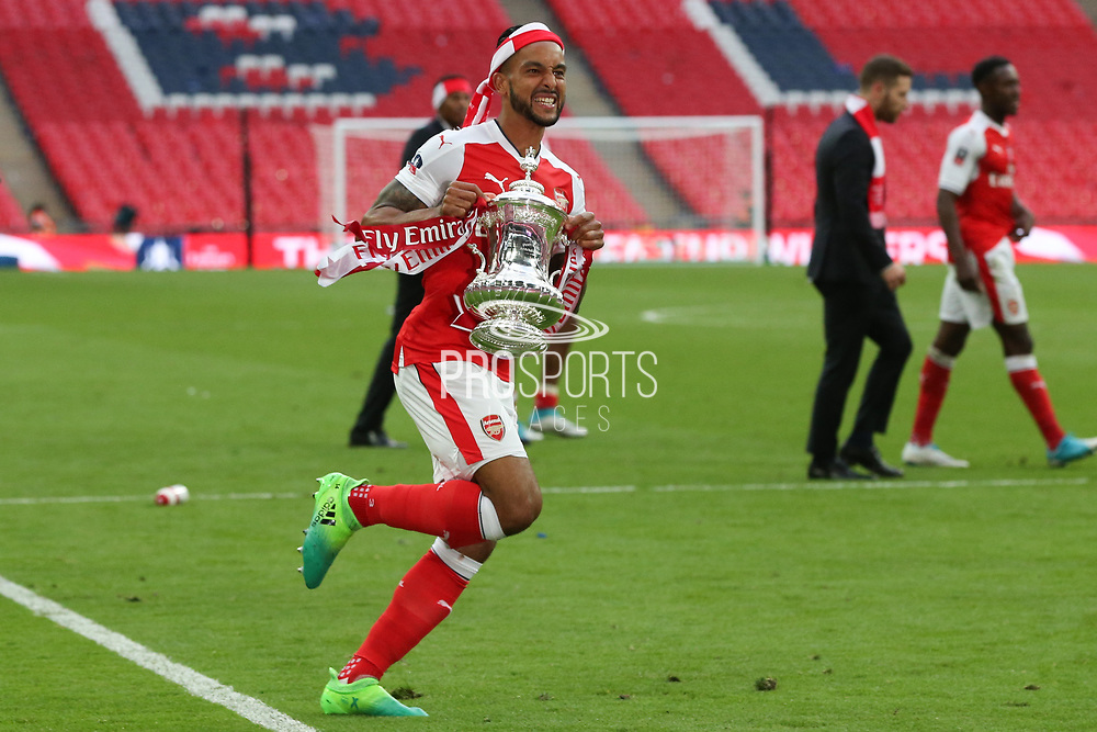 Arsenal's Theo Walcott(14) runs with the cup during the The FA Cup final match between Arsenal and Chelsea at Wembley Stadium, London, England on 27 May 2017. Photo by Shane Healey.