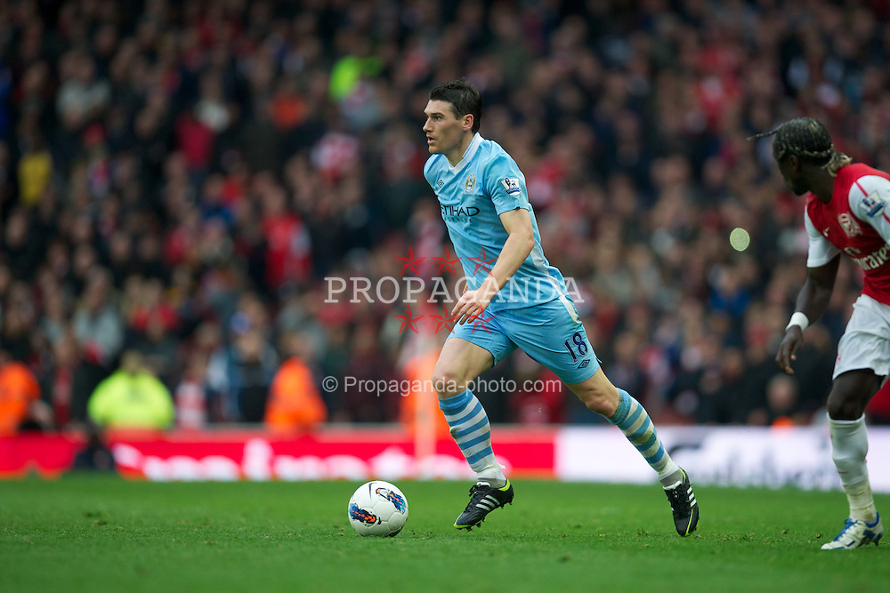 LONDON, ENGLAND - Easter Sunday, April 8, 2012: Manchester City's Gareth Barry in action against Arsenal during the Premiership match at the Emirates Stadium. (Pic by David Rawcliffe/Propaganda)