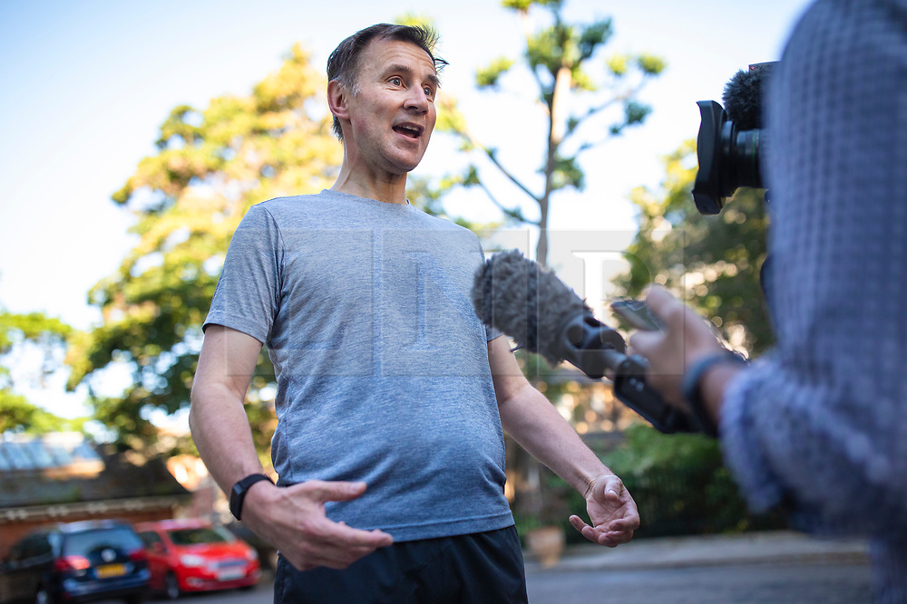 © Licensed to London News Pictures. 20/06/2019. London, UK. Foreign Secretary Jeremy Hunt, who is running to become the Leader of the Conservative Party and next Prime Minister, speaks to the media outside his London home after a run. The final two candidates will be put to the party membership in a ballot. Photo credit: Rob Pinney/LNP