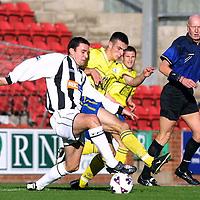 Dunfermline v St Johnstone    27.10.01<br />New St Johnstone player Mark Lynch tackles John Potter<br /><br />Pic by Graeme Hart<br />Copyright Perthshire Picture Agency<br />Tel: 01738 623350 / 07990 594431