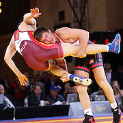 Logan Stieber, USA, (blue) in action against Opan Sat, Russia, (red) as wrestlers from USA, Iran and Russia compete at Grand Central Terminal as part of the Beat the Streets Gala. Billed ?The Rumble On The Rails,? the international wrestling event showcased competition as part of World Wrestling Month. Vanderbilt Hall, Grand Central Station, Manhattan,New York. USA. 15th May 2013. Photo Tim Clayton