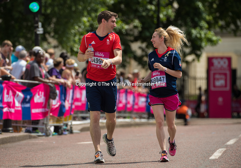 David King and Stacey King finish in the Olympian Wave at the finishing line outside Buckingham Palace at The Vitality Westminster Mile, Sunday 28th May 2017.<br /> <br /> Photo: Thomas Lovelock for The Vitality Westminster Mile<br /> <br /> For further information: media@londonmarathonevents.co.uk
