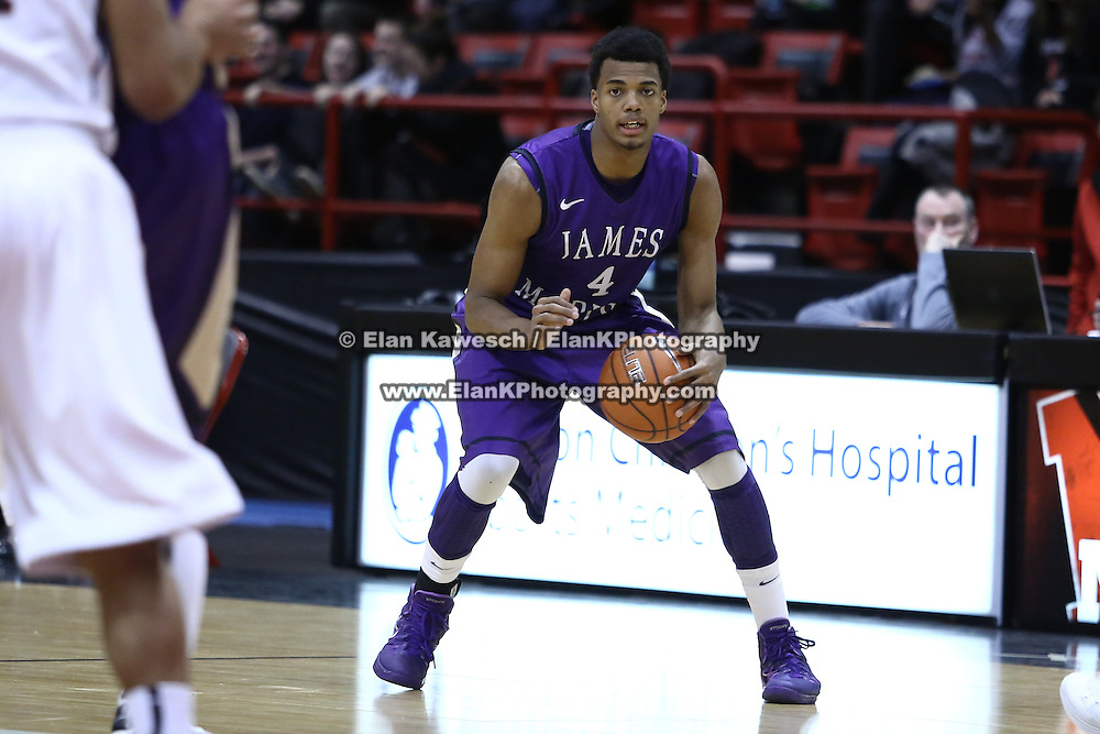 Charles Cooke #4 of the James Madison University Dukes controls the ball during the game at Matthews Arena on January 29, 2014 in Boston, Massachusetts . (Photo by Elan Kawesch)