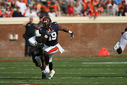 Virginia wide receiver Emmanuel Byers (19) outruns Wyoming cornerback Marcell Gipson (31).  The Virginia Cavaliers defeated the Wyoming Broncos 13-12 in overtime on September 9, 2006 at Scott Stadium in Charlottesville, VA.