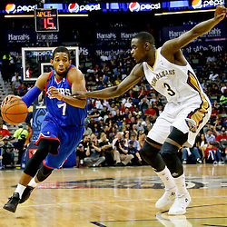 Nov 16, 2013; New Orleans, LA, USA; Philadelphia 76ers point guard Darius Morris (7) drives past New Orleans Pelicans shooting guard Anthony Morrow (3) during the first half of a game at New Orleans Arena. Mandatory Credit: Derick E. Hingle-USA TODAY Sports