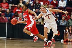 March 19, 2011; Stanford, CA, USA; St. John's Red Storm guard Keylantra Langley (20) dribbles past Texas Tech Lady Raiders forward Jordan Barncastle (1) during the second half of the first round of the 2011 NCAA women's basketball tournament at Maples Pavilion. St. John's defeated Texas Tech 55-50.