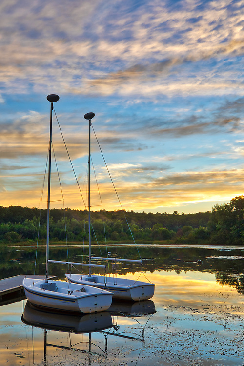 Massachusetts sunset photography from Wellesley College at Lake Waban in Wellesley Massachusetts showing a couple sailboats with surrounding beautiful evening hues. This Massachusetts lake with Wellesley College nearby are inspiring and make for a beautiful New England nature photography location to visit and to get lost with a camera.<br /> <br /> Lake Waban sunset photos are available as museum quality photo, canvas, acrylic, wood or metal prints. Wall art prints may be framed and matted to the individual liking and wall art d&eacute;cor project needs:<br /> <br /> https://juergen-roth.pixels.com/featured/sailing-lake-waban-juergen-roth.html<br /> <br /> Good light and happy photo making!<br /> <br /> My best,<br /> <br /> Juergen<br /> Photo Prints &amp; Licensing: http://www.rothgalleries.com<br /> Photo Blog: http://whereintheworldisjuergen.blogspot.com<br /> Instagram: https://www.instagram.com/rothgalleries<br /> Twitter: https://twitter.com/naturefineart<br /> Facebook: https://www.facebook.com
